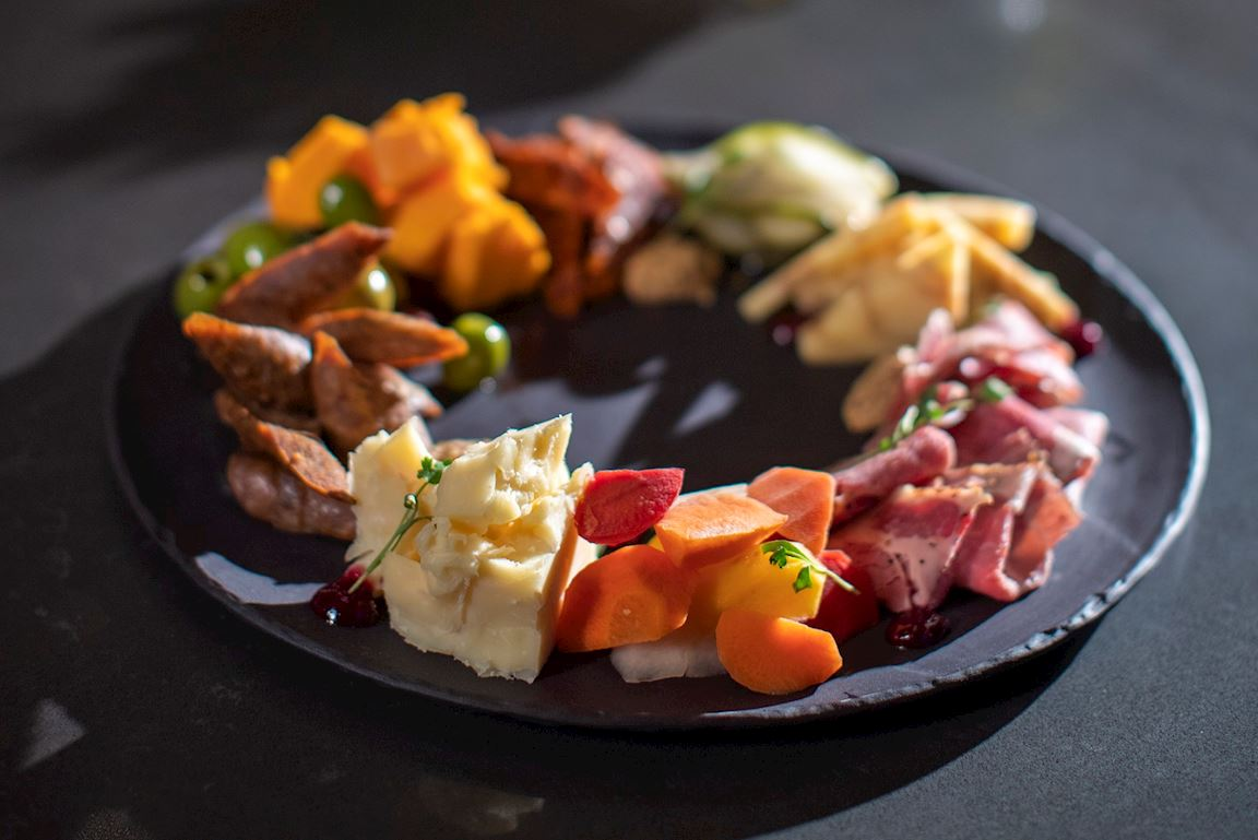 Stockyards Platter featuring curated meats and cheeses in a circular presentation.