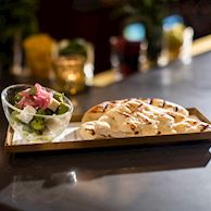 Marinated olives and grilled flatbread