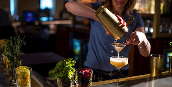 Bartender pouring cocktail
